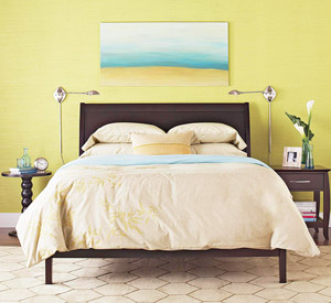 Blue painting over tan bed