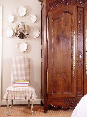 Wood armoire by plaid chair