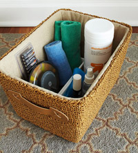 basket with cleaning supplies and batteries