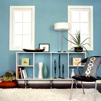 Decorating ideas under 100 dollars blue wall room with white shelf unit
