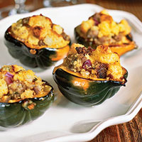 Acorn Squash with Sausage, Onion, and Sage Corn Bread Stuffing