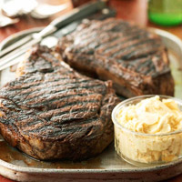 Image of Ancho-rubbed Rib Eye Steaks With Grilled Papaya Butter, Better Homes and Garden