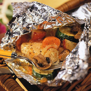 Chicken vegetable bundles midwest living for Chicken and vegetables in foil packets recipe