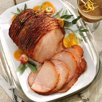 Baked Holiday Spiral Ham with Raisin Sauce | Midwest Living