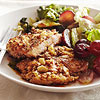 Pecan-Crusted Chicken Thighs with Braised Greens and Grapes