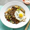 Frizzled Eggs over Garlic Steak and Mushroom Hash