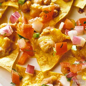 Nachos with melted cheese and tomato