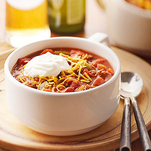 bowl of chili with sour cream