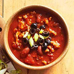 Mild Turkey Chili with Sour Cream and Black Olives