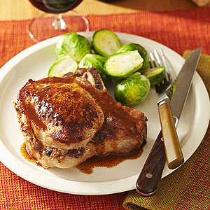 Cranberry Sausage Stuffed Pork Chops with Pumpkin Butter Gravy