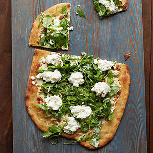 White pizza with arugula lemon parmesan and ricotta
