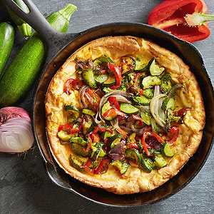 Cheesy Dutch Baby with Pesto-Dressed Vegetables