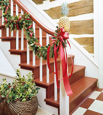 Keeping the christmas spirit alive 365 25 ways to for Stair railing decorated for christmas
