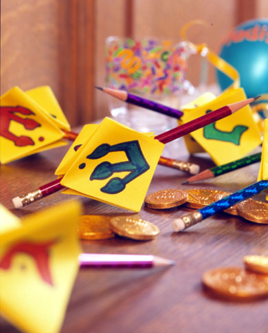 Pencil and paper dreidels for Hanukkah crafts for adults