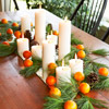 Candle and Clementines Centerpiece
