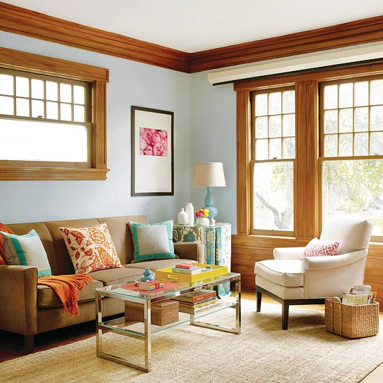 Color Pattern And A See Through Coffee Table Turned This Brown Boxy Room Into Vibrant Finished Space The Photograph In An Oversize Frame Fills