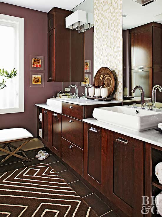 dark stained wood cabinetry paired with plum walls heighten the drama in a bathroom these deeper colors arent timid or shy their depth together - Bathroom Cabinets Colors