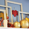 Fall Mantel with Frames, Candles, and Pumpkins