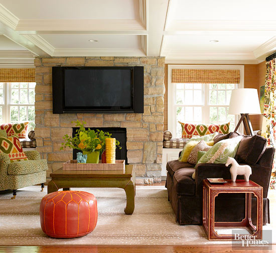 color ideas for living room with brown couch. This room s brown couch looks right at home next to other nature inspired  colors such as the orange pouf warm chartreuse green coffee table Ways Decorate with a Brown Sofa