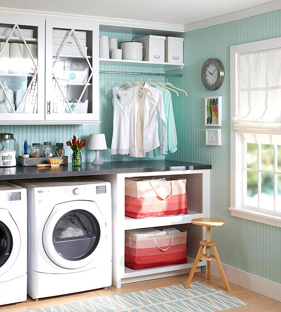 in the washing area deep base cabinets house the appliances and wall cabinets hung above keep detergents and supplies within easy reach