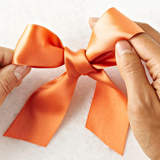 Jun 15,  · To tie a bow, start by tying a knot in the center of a piece of ribbon or string. If you're tying the bow around a package, wrap it around the package first and then tie the knot. Next, make a loop with the ribbon to the left of the knot%(2).