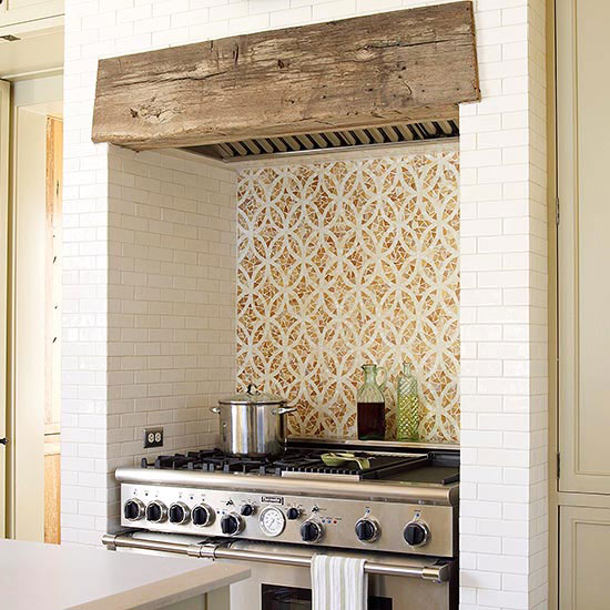 create the look of a fireplace hearth with decorative tile this range tucks into a niche with decorative tile and a rustic lintel