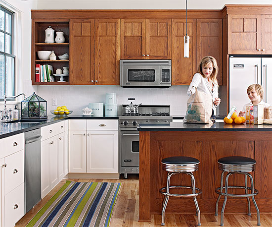 twotone kitchens are desirable in the marketplace and a growing trend in kitchen design consider painting a block of cabinets such as the lowers