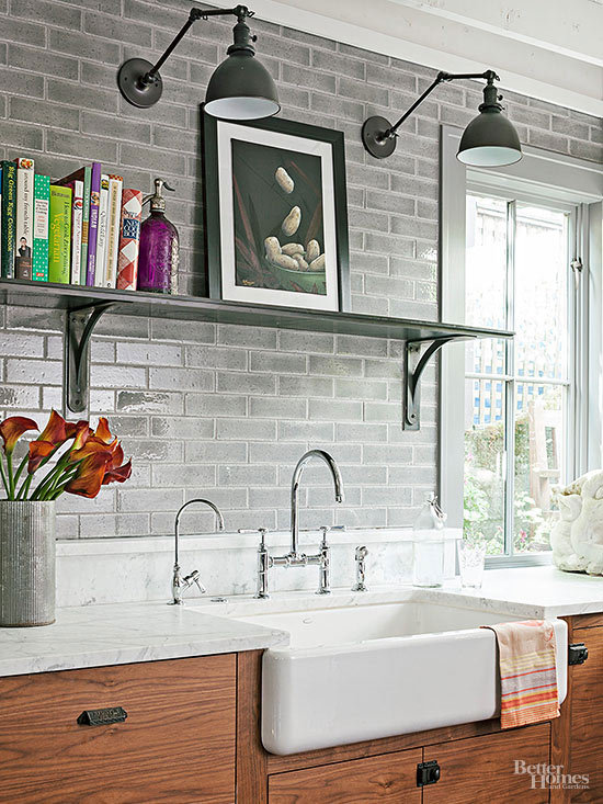 Swing arm sconces are an interesting lighting look in this rustic kitchen. via BHG.com