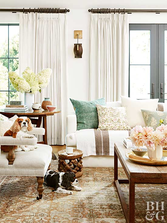 the been here forever sensibility in her home comes from accessories and furniture that display the patina of age the living rooms mix includes a vintage