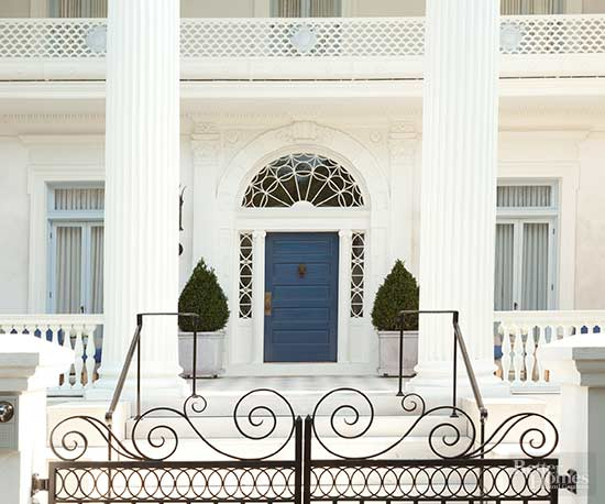 this elegant allwhite exterior demands a focal point draw eyes to its entrance with a peppy but not too bright shade of blue