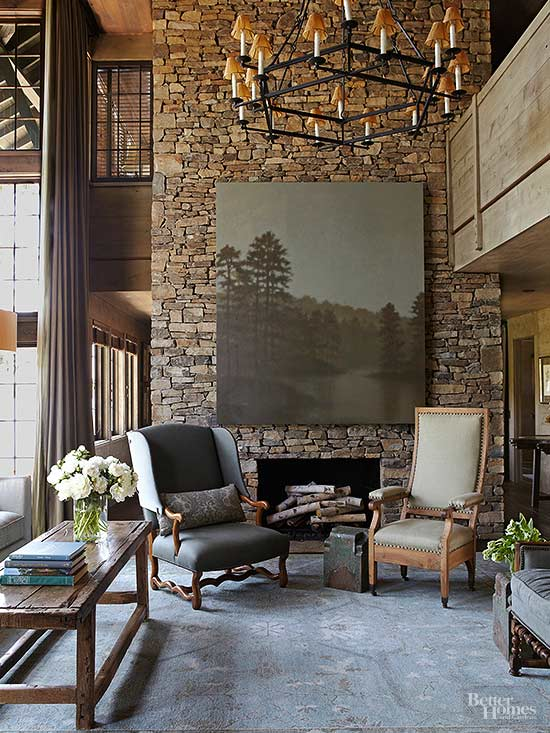 the play of light and shadows across a fireplace brings a mesmerizing quality to any interior here native alabama fieldstone towers to the
