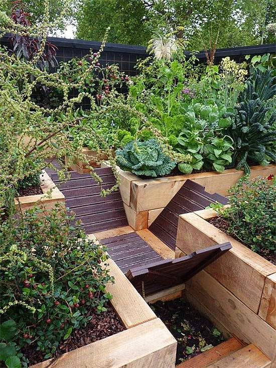 this idea from rachael mathews is pure genius she compost bins into trenches that double as a walkway through the garden beds