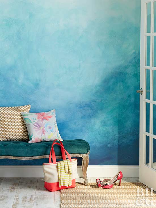 An oh-so-trendy ombre wall is surprisingly simple to DIY. Start by painting  the wall a base color. Then use a sponge to apply a darker paint color.