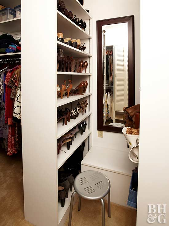 dont just build a wall raise a partition that brings utility to a small walk in closet design this bookcase divider handily holds shoes galore and - Small Walk In Closet Design Ideas
