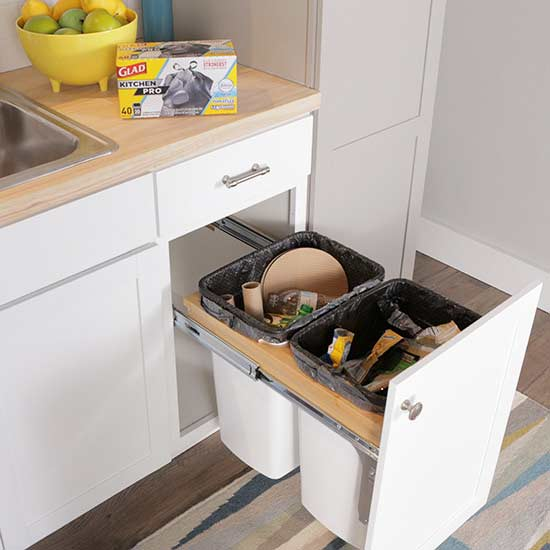 visible trash cans in the kitchen can be have you considered storing your trash out of sight a diy pullout trash cabinet