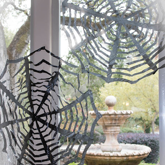 spiderwebs you dont need to clean up - Friendly Halloween Decorations