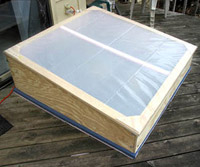 a cold frame is a bottomless box with a window like a miniature greenhouse a cold frame lengthens the gardening season by protecting plants