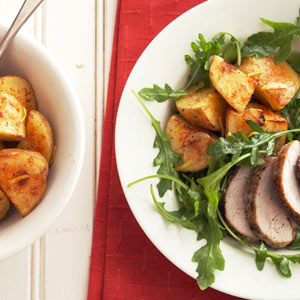 Skillet Roasted Potatoes with Pork and Wilted Arugula