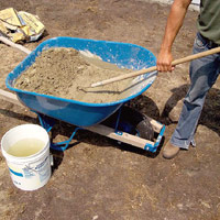 Mix concrete in wheelbarrow