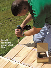 Laying the Decking, Install fasteners along chalk line