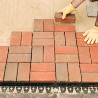 Lay bricks along pyramid