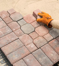 Continue laying pavers