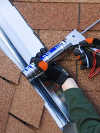Caulk between shingles and flashing