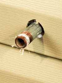 Hole in siding for utilities