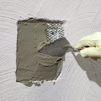Apply ready-mix stucco