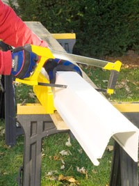 Cut gutter with hacksaw