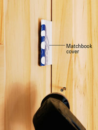 Use matchbook cover as spacer