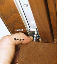 Bracket and pivot pin