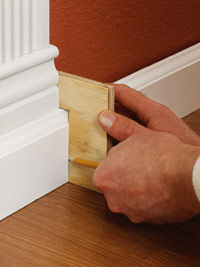 Use notched plywood to mark baseboard
