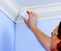 Installing plaster-faced crown molding, Smooth joints with sanding sponge